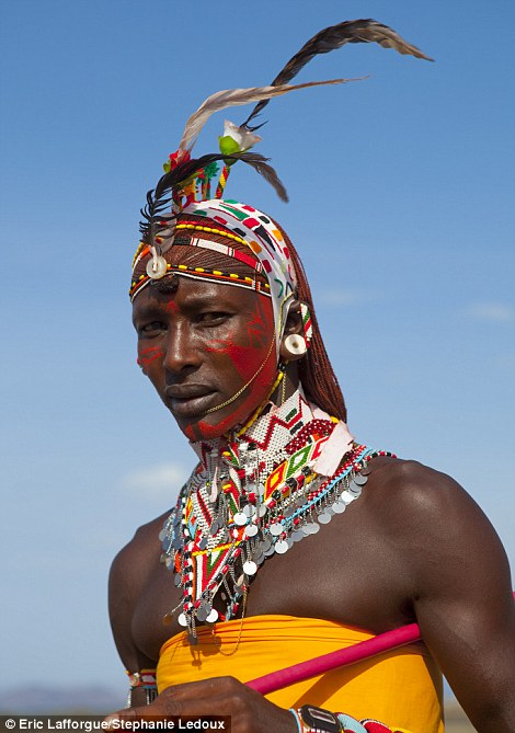 Striking: A Samburu man shows off his elaborate ensemble
