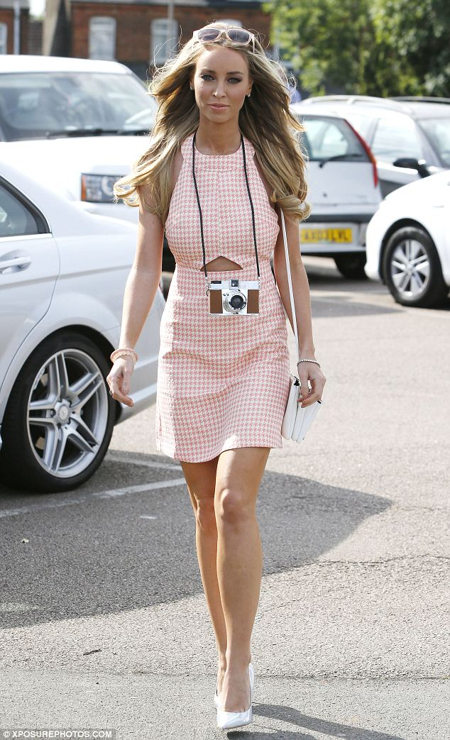 'Fashion blogger Barbie: Lauren Pope is stunning in a halterneck dress with a camera around her neck