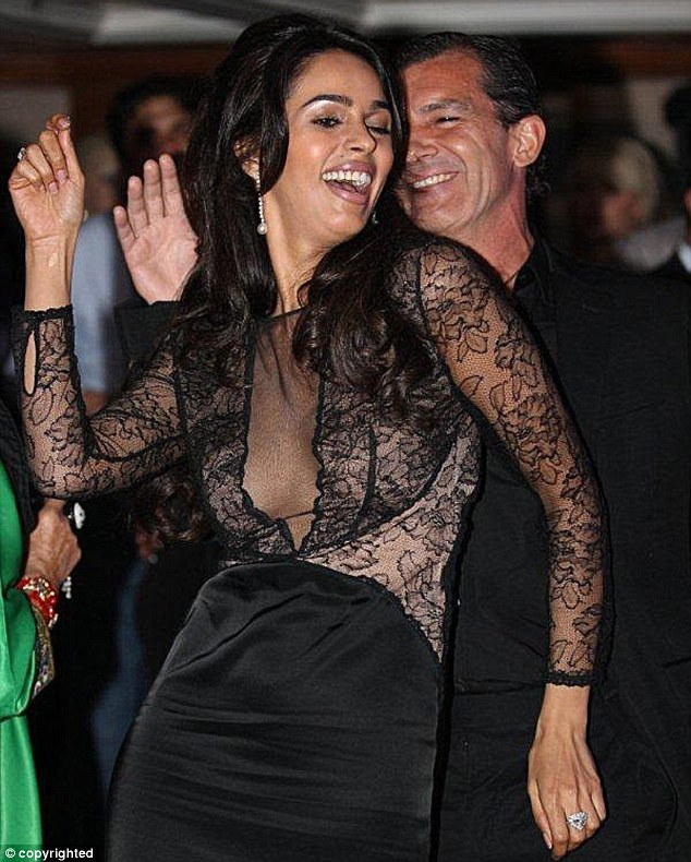 No romance here: On Thursday Mallika Sherawat denied to E! Online that she had a relationship with Antonio, who she is pictured with here at the Cannes Film Festival in 2012