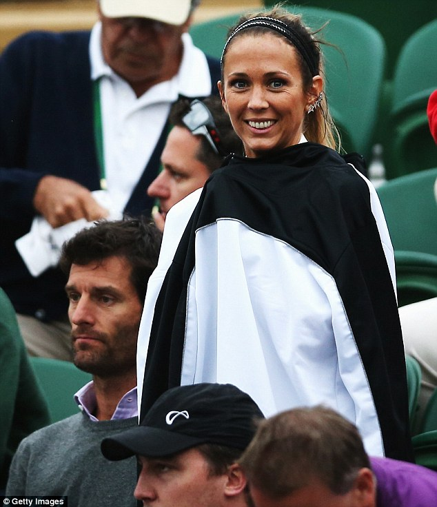 Toasty: Appearing to feel the chill later in the match, the Sydney-born actress draped what looked like a large, men's sports jacket over her chest