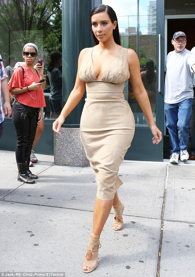 Demure: The 33-year-old reality star strode along the pavement with her sisters Kourtney and Khloe not far behind while they headed to a meeting together