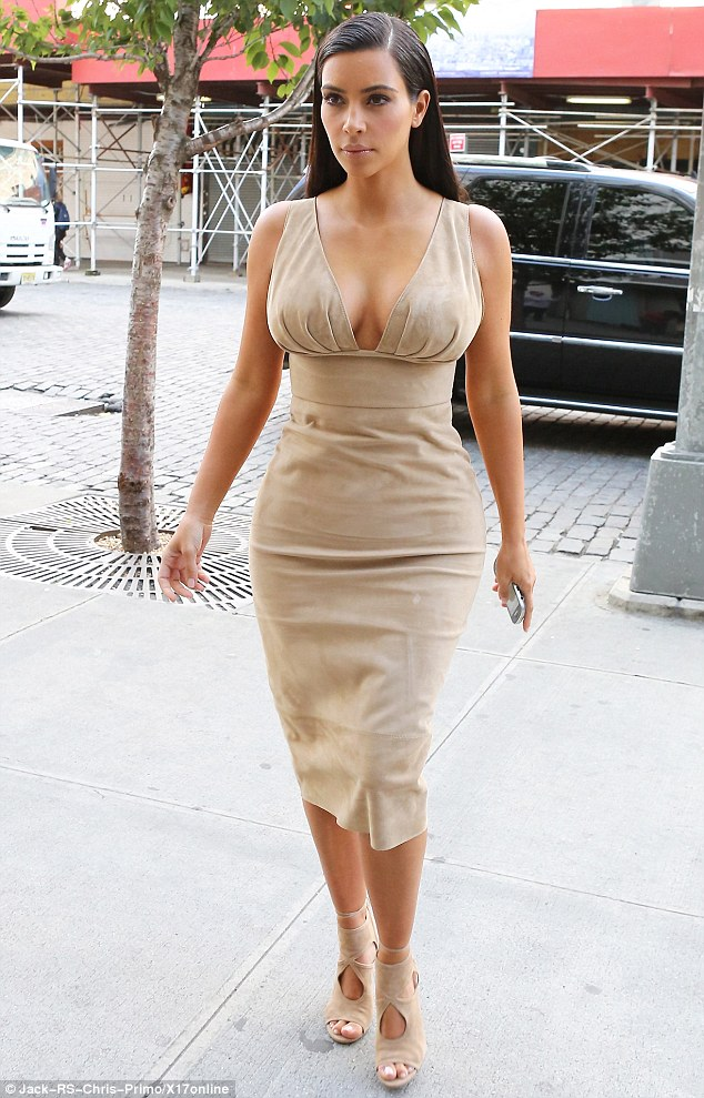My how she's changed! On Thursday, Kim Kardashian was spotted in New York City looking entirely different from her previous years in a nude dress featuring a plunging neckline