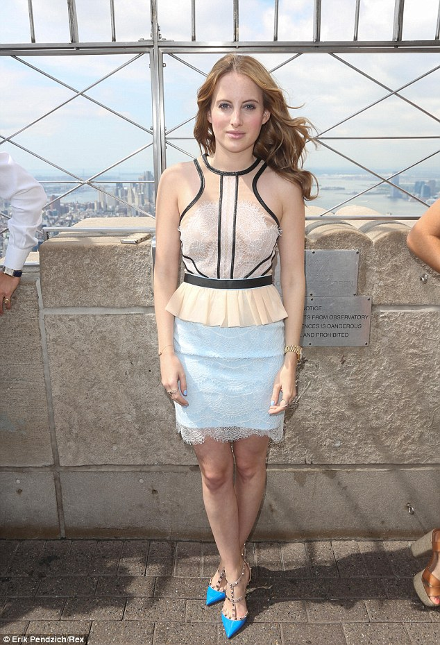 Lacy lady: Rosie Fortescue lived up to her fashion blogger credentials in a slightly more high fashion look as she teamed a lacy nude peplum top with a duck egg blue lace skirt