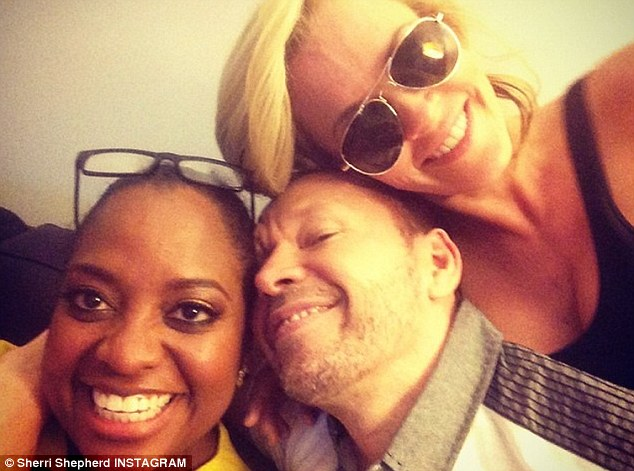 Cuddly farewell: Jenny's fiancé Donnie Wahlberg cuddled up to his gal and Sherri Shepherd too in this cute instagram