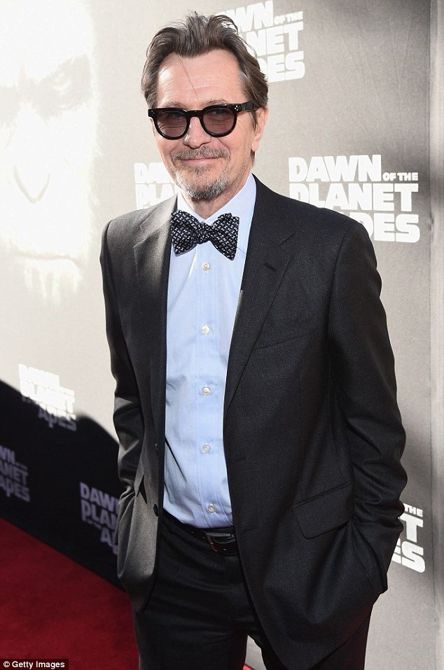 Behind shades: The 56-year-old British actor kept himself hidden underneath tinted shades as he hit the carpet