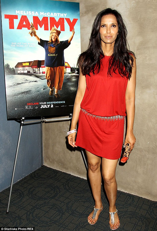 Seeing red: Highlighting her flawless olive competition, Padma wore a striking bright red simple shift dress that was cinched in at her hips with a silver metallic belt