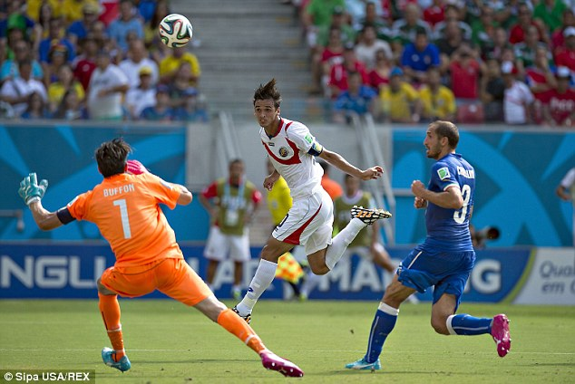 Up for it: Bryan Ruiz's (centre) header against Italy gave Costa Rica a surprise 1-0 win in their Group D clash
