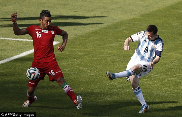 Heartbreaker: Argentina captain Lionel Messi (right) scored a late winner against Iran in their 1-0 victory