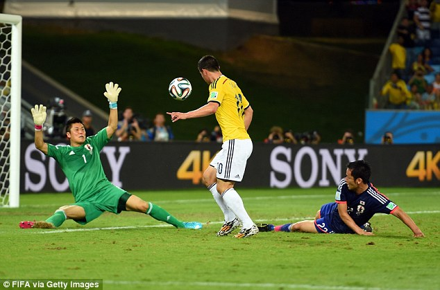 Twisted blood: Colombia's James Rodriguez (centre) slalomed past Japan's defence before scoring