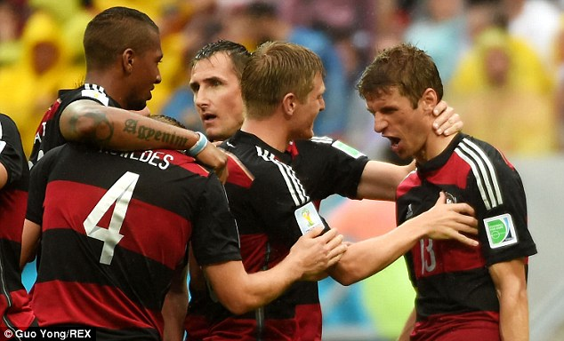 Efficient: Thomas Muller (right) has scored four goals at this summer's World Cup so far
