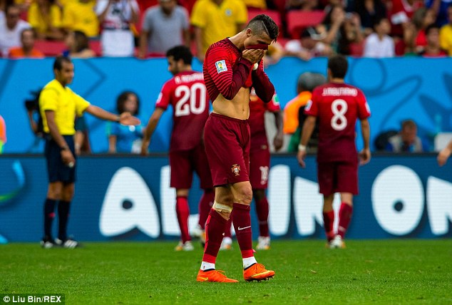 Going home: Ronaldo trudges off the pitch after Portugal's win over Ghana fails to see them through