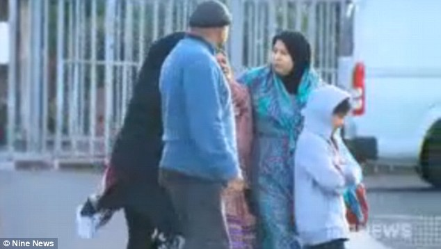 His family, pictured at a mosque on Friday, initially thought someone had taken him after the snow completely buried him