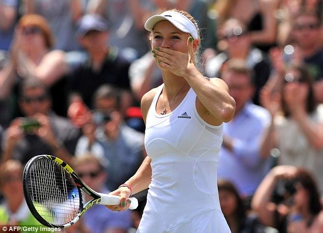 Sealed with a kiss: Caroline Wozniacki salutes the crowd after her win over Ana Konjuh