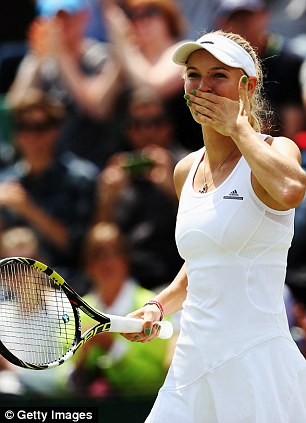 Caroline Wozniacki celebrates after winning her third round match