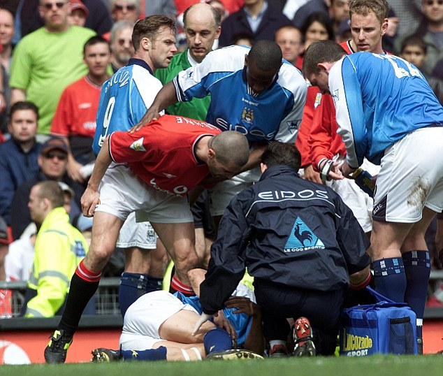 Horror tackle: Roy Keane (left) was sent off for his premeditated lunge on Alfe-Inge Haaland (bottom) in 2001