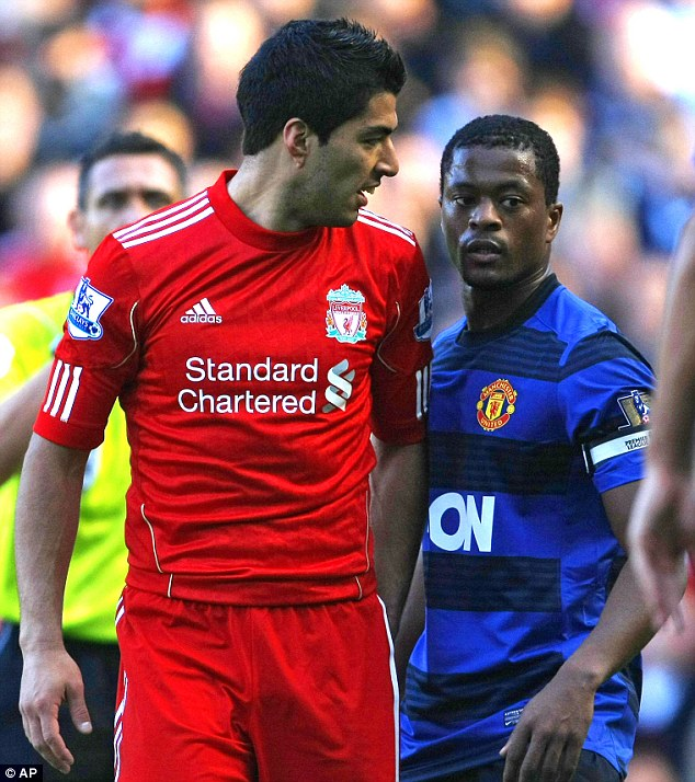 Disgrace: Suarez (left) was found guilty of racially abusing Patrice Evra (right) and banned for eight games