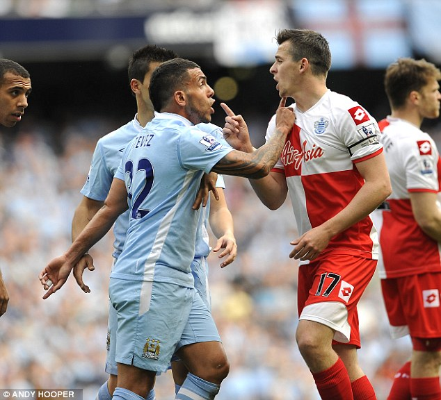 Bad boy: Joey Barton (right) was sent off for lashing out at Carlos Tevez (left) in 2012