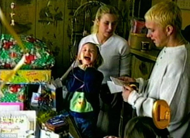 Flashback: Eminem pictured with his ex-wife Kim Scott and Hailie in a home video featured in his 2005 music video for Mockingbird