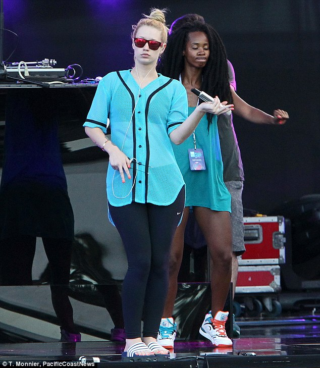 Rehearsals: Will the other members of her stage show practiced in trainers, Iggy was forced to wear 'slides' as she did a stage run through
