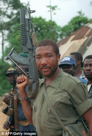 The West African country had been in a vicious civil war for years, but now the RUF - ordered into battle by the president of neighbouring Liberia, Charles Taylor (above) - were closing in on the capital, Freetown
