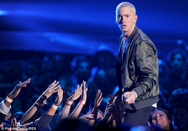 Still going strong: The 41-year-old rapper performing at the MTV Movie Awards in April