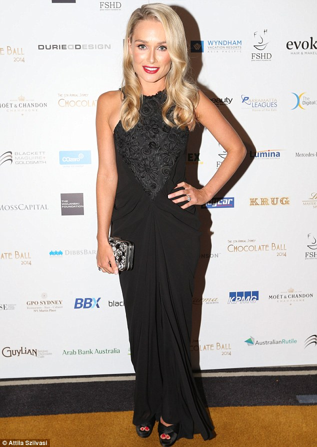 Black tie: The stunning blonde wowed in an all-noir floor-length gown with draping and lace detail