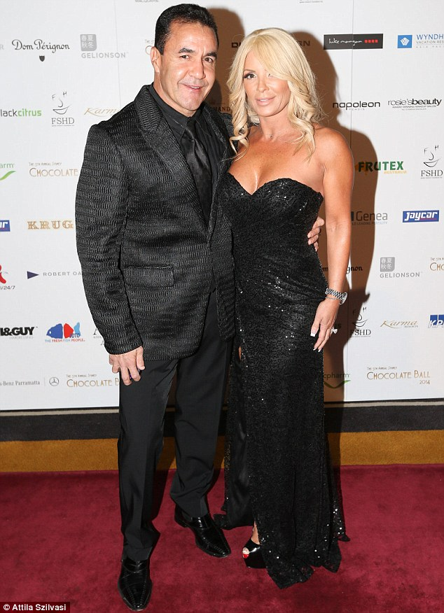 Fighting fit: Retired Australian boxer Jeff Fenech with his wife Suzee at the fundraising evening