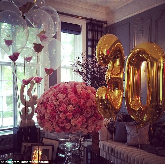 Lucky lady: The brunette beauty was greeted by a room filled with flowers and balloons. She captioned the photo: '@pstunt love you so much thank you loved waking up to these beautiful flowers'