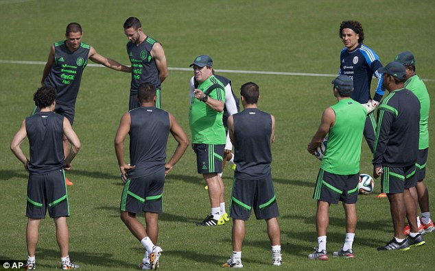 Practice: Mexico coach Miguel Herrera (centre) will hope his side end their penalty shootout hoodoo