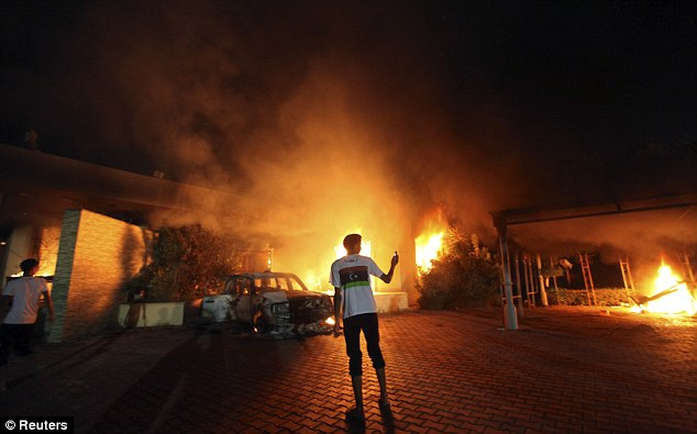 Attack: The U.S. Consulate in Benghazi is seen in flames on September 11, 2012