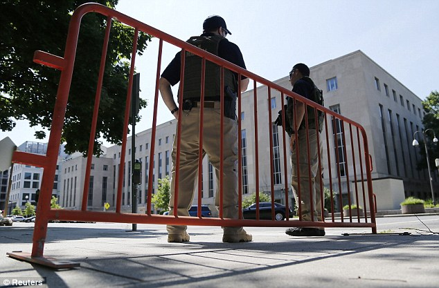 Protection: U.S. Federal Marshals patrol outside the U.S. federal courthouse in Washington on Saturday