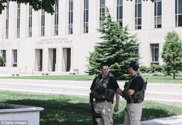 Keeping guard: U.S. Marshals are seen outside the E. Barrett Prettyman United States Courthouse on Saturday