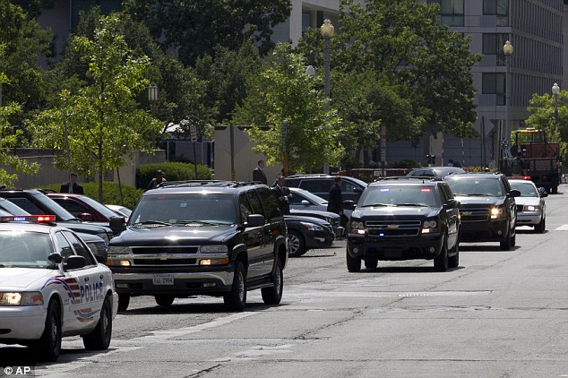 Departure: The motorcade transporting Abu Khattala leaves the federal U.S. District Court Saturday after Khattala pleaded not guilty to conspiracy at his first appearance in federal court in the U.S.