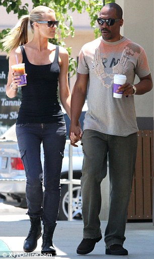 Eddie Murphy and Paige Butcher went out for coffee in LA. The model wore a tight black singlet and skinny jeans, while Eddie chose loose cargo pants and a graphic t-shirt