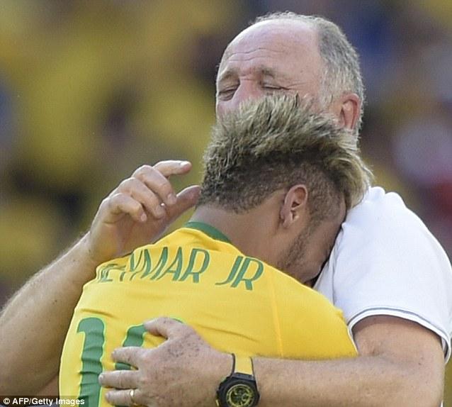 Embrace: Neymar struggles to hold back his emotions as he hugs his boss Luiz Felipe Scolari