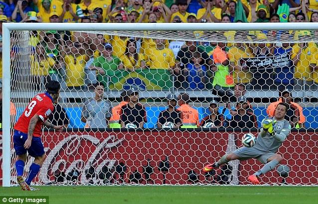 Stopper: Cesar saving the penalty of Mauricio Pinilla during the shootout