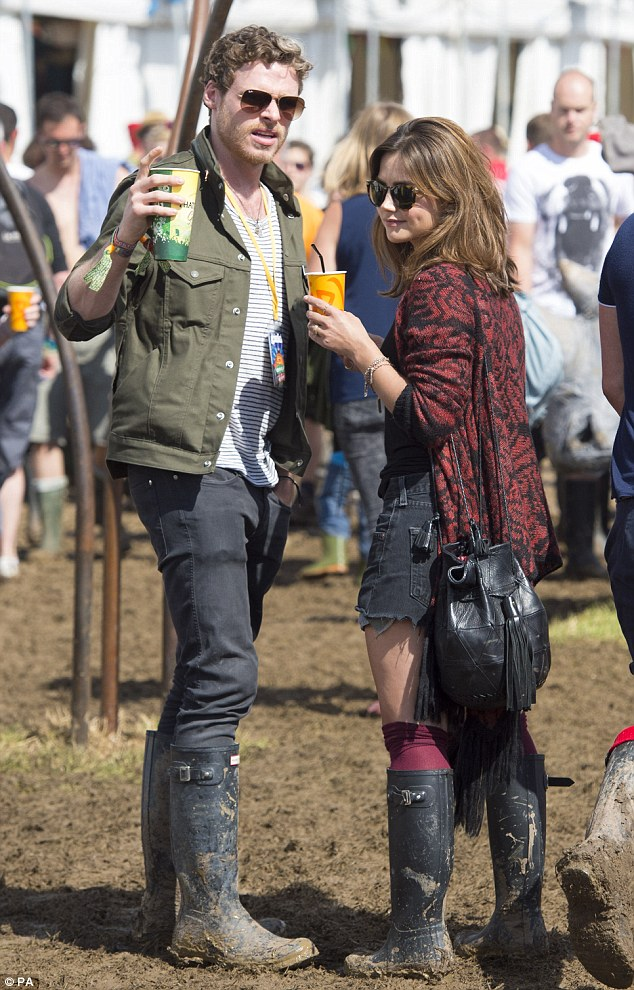 The sound of music: Jenna Coleman and Richard Madden looked relaxed as they spent time backstage at Glastonbury on Saturday