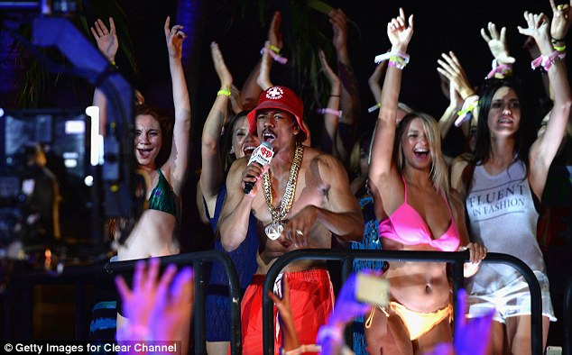 Red hot! Nick sported a bucket cap with matching shorts and plenty of gold chains