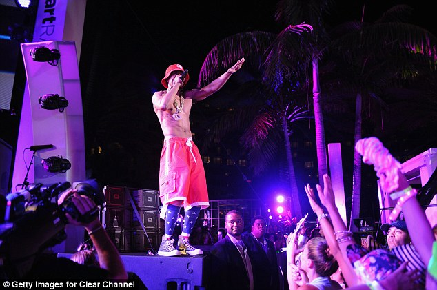 Good energy: Onlookers threw their hands in the air as the 33-year-old rapper performed