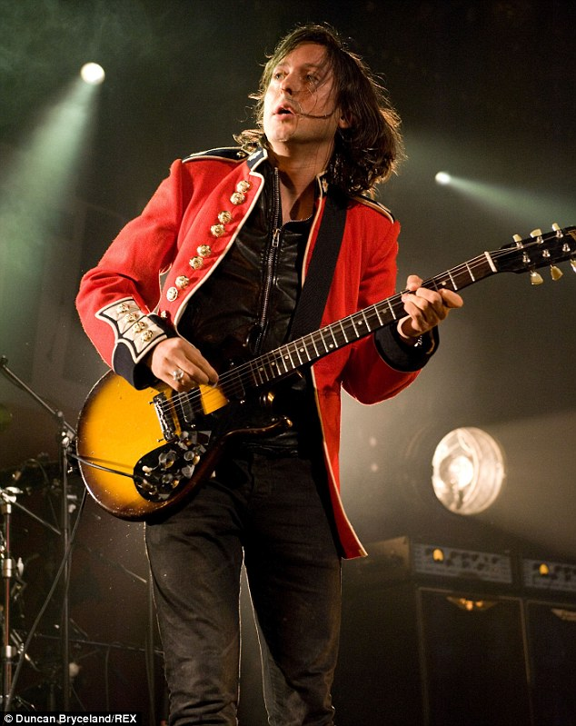 Same old style: Carl wore a red guard's jacket - which the band used to wear in 1997