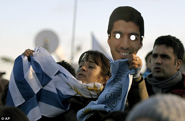I see you! Uruguay supporters wore Suarez masks before and during their defeat against Colombia