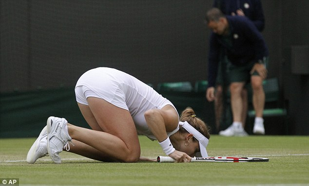 Sealed with a kiss: Cornet kisses the ground after her win