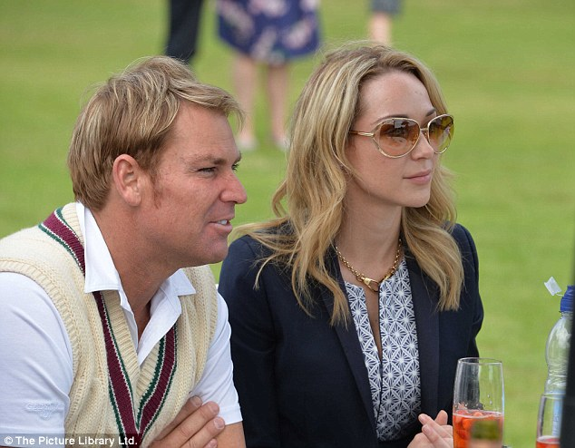 Showing his true colours: Shane eventually shed his formal wears and rocked more traditional cricket garbs