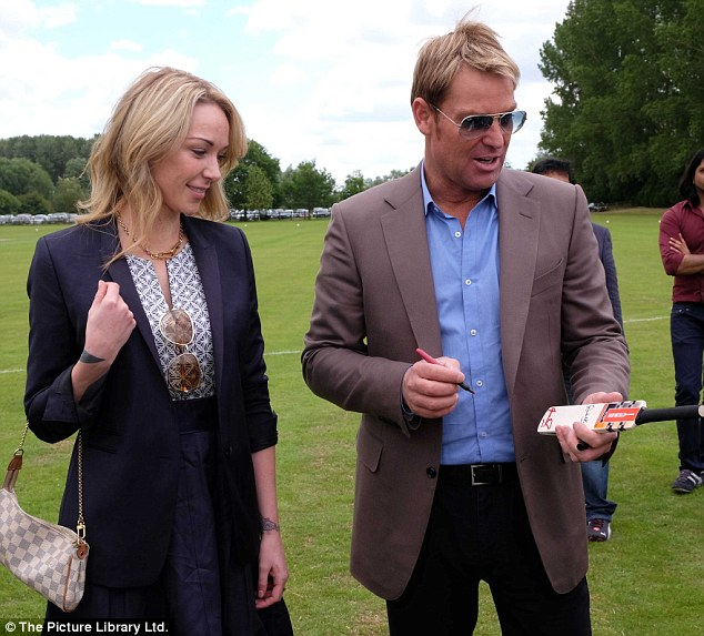 Legend: The King Of SpinShane met with fans and signed miniature cricket bats