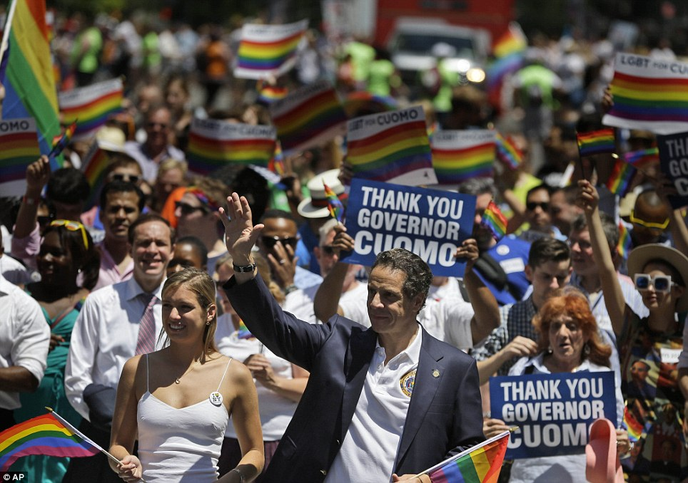 New York Gov. Andrew Cuomo marches in the Gay Pride Parade in New York on Sunday