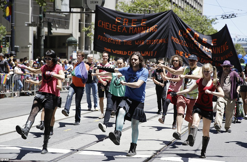 A group in San Francisco marches in support of the release of Chelsea Manning, who was sentenced to 35 years in prison for the release of classified information through WikiLeaks