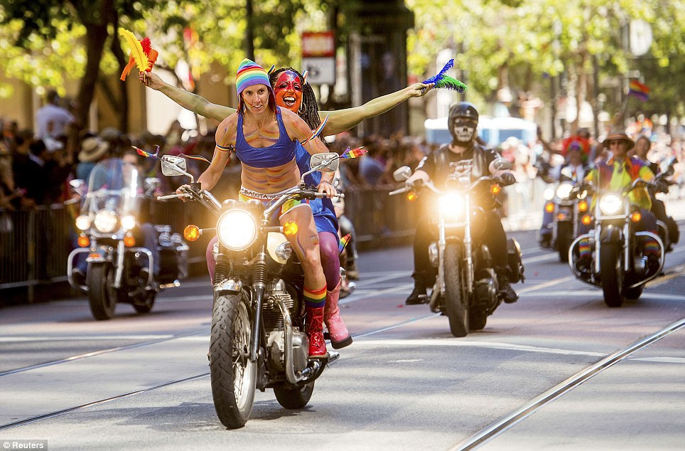 Riders from the lesbian motorcycle club 'Dykes on Bikes' ride through the streets in San Francisco