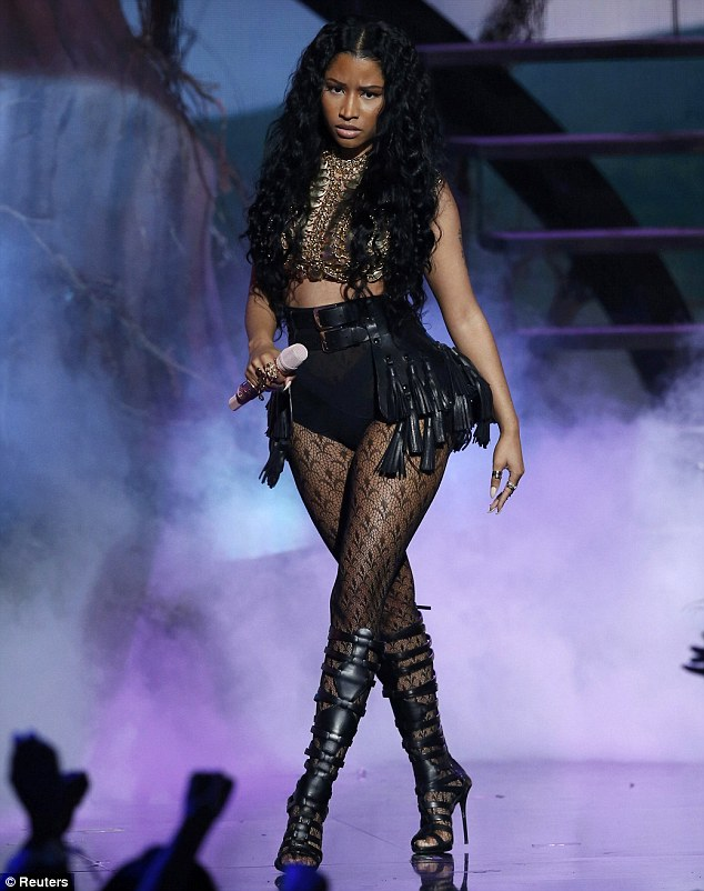 Doing what she does best: Not only did Minaj perform her latest single Pills N Potions at the BET Awards in LA on Sunday, but she was also accused of 'throwing shade' at fellow performer Iggy Azalea