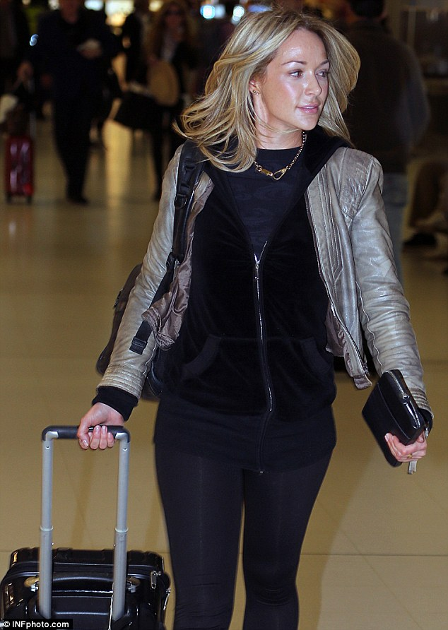 Jetting out: Emily was seen jetting out of Sydney last week