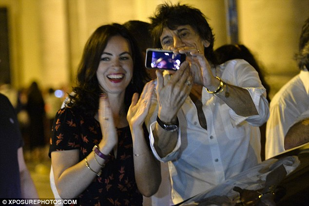 Having fun: Ronnie was accompanied by wife Sally Humphreys when they went out to dinner in Rome last week - where they took some selfies